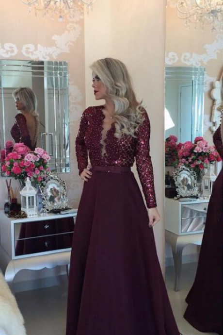 Dark purple row with long sleeves, ball gown, bridesmaid dresses.